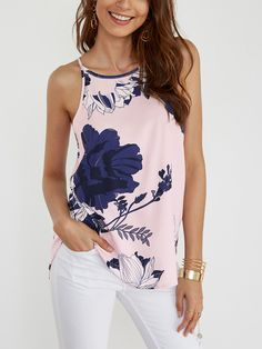 This cami is our current obsession and it is a must have item. Featuring random floral print, halter design, sleeveless design and curved hem. Perfect with shorts or jeans.