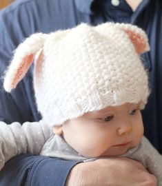 Free Knitting Pattern for Easy Lamb Baby Hat - Easy baby hat knit in seed stitch with ears knit separately. Designed by Little Red Window. 6 months size is free on the web page.