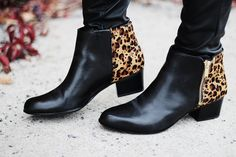 black leather booties with a touch of gold