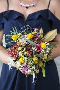 Australian Native flower bouquet with billy buttons, paper daisies, flowering gum, wax flowers, flannel flowers, kangaroo paw and scarlet banksia Flowers: The Wildflower Place / PC: Coast Wedding Photography