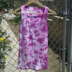"""NWOT NordicTrac Tie Dye Tank Top Cute pink and white tie dyed tank top. 100% cotton. Great for working out or anytime. New without tags. Measures about 26.5"""" long. No holds, Paypal, or trades. NordicTrac Tops Tank Tops"""