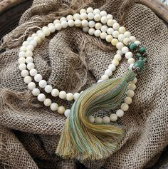 Mala necklace made of 108, 8 mm - 0.315 inch, beautiful shell gemstones and decorated with turquoise and a handmade Nepalese guru bead - look4treasures on Etsy