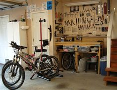How to Set Up a Home Bike Shop For Every Space and Budget - Singletracks Mountain Bike News Bycicle Embroidery, Bycicle Trailer Bike Work Stand, Bike Repair Stand, Build Your Own Bike, Triathlon, Bike Room, Bike Shed, Bicycle Garage, Bike News, Bicycle Shop