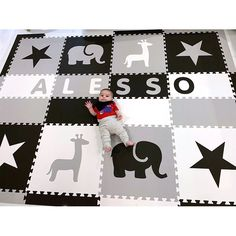 SoftTiles Easy Personalize play mat in black, light gray, and white. This mat is x feet and can fit a name up to 8 letters. SoftTiles are nontoxic high quality foam play mats with specially designed sloped borders to help prevent tripping. Playroom Flooring, Alesso, Safari Animals, Nursery Design, Kid Names, Your Child, Latex, How To Memorize Things, Play Mats