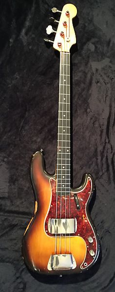Vintage 1959 Fender Percision Bass with original tweed case. Everything On This Beauty Is OriginalThe Finish Is All Original.All Parts/Pickups/Electronics Are OriginalOriginal Frets With Enough Life Left.Truss Rod Functions.Plays like butter and fits in your hand like an old glove.Tone is fat and...