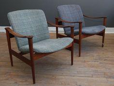 Pair of Model 711 teak lounge chairs by Fredrik A. Kayser for Vatne Lenestolfabrikk , Norway, 1960. Beautifully sculptural solid teak frame and original tweed upholstery. Condition: v. good.