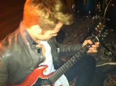 Chris Pine with guitar