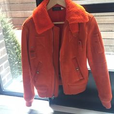 Bright Orange Shearling Jacket from Ralph Lauren Warm, cozy shearling jacket with aviator style and bold color from Polo Ralph Lauren. Very light wear. The tag is XS but this would also fit most smalls. Ralph Lauren Jackets & Coats