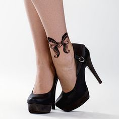 Bow lace tattoo design I like the design not necessarily where it is placed though