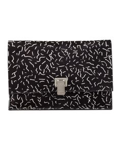 #BGSale - our accessories director Ana Maria Pimentel's Fashion Month Must - Proenza Schouler's oversized clutch. 212 872 2601