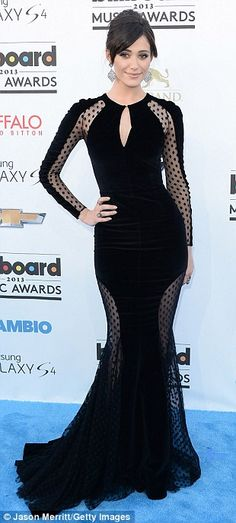 Flashing flesh: Three starlets showcasing sheer designs were Emmy Rossum in an elegant long-sleeved gown, the Canadian 27-year-old, and Jennfier Morrison looked like she was wearing lingerie
