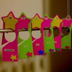 DIY closet dividers for baby clothes using foam door hangers.