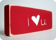 Cute!  Could also make on three individual distressed red wood blocks -- I <3 U
