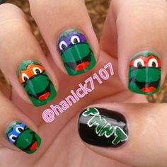 Sparkly red tips with one ninja turtle nail for Meaty's birthday