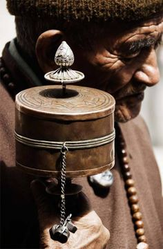 """Tibetan Prayer Wheel - Prayer wheels contain prayers copied thousands of times on very long scrolls of paper. The act of spinning the wheels """"activates"""" the prayers and sends them out into the world. ALWAYS spin the prayer wheel in a clockwise direction."""