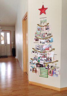 Washi tape, a tinsel garland, tacks, and a red star create a vibrant holiday card tree.