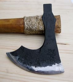 Hand forged battle ready Viking axe, comes with leather sheath.