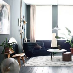 A home of collector Theo Bert Pot in rich, warm tones. (Loving the Togo sofa in green velvet!)