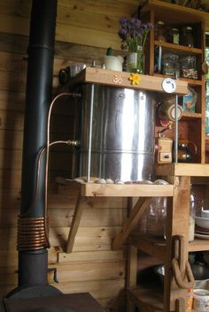 This tiny house has some ingenious ideas incorporated into it – my favorite being the flue of the stove being used to heat the water.