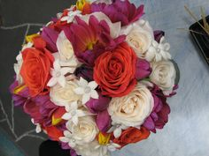 Beautiful bride's bouquet of ivory and orange roses, hot pink dahlias and stephanotis. By Pamela for Michael's Flower Girl
