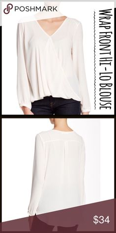 "Wrap Font Hi-Lo Blouse This blouse is awesome! I own it in almost every color. The wrap front is so cute with tunic length coverage in the back.  A hi-lo top is cut from solid woven fabric into a surplice profile with button cuffs. - Surplice neck - Long sleeves - Button cuffs - Back yoke with box pleat - Approx. 22"" front length, 26"" back length - Imported  Fiber Content: 100% polyester Tops"