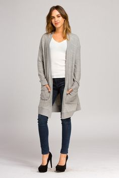 Loose fit, long sleeve, open closure long cardigan. Contrast sleeve band. Contrast waistband. Contrast banding at opening. Has pockets at sides. The self fabric of this cardigan is a medium weight, brushed two-toned knit fabric that has a very soft fuzzy texture, drapes beautifully and stretches well. The contrast fabric of this cardigan is a medium weight, brushed two-toned ribbed knit fabric that has a very soft fuzzy texture and stretches well. Fabric : 79% Polyester 14% Rayon…