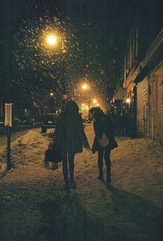 I wanna walk with nothing but the street lights to show the way as snow falls with my best friend