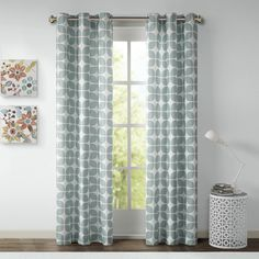 This geometric printed panel pair is the perfect modern update for a bold and fun look. The geometric design is featured in a dark grey and white for a neutral touch.