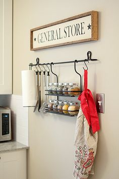 Clear containers, dry erase marker to label spices, cute sign and apron. Love.
