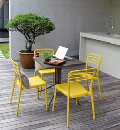 What sharp chair! The yellow looks so great on the Louvre Chair from Jadon Outdoors