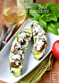 Italian Tomato-Basil Stuffed Zucchini is a light and low-carb, gluten-free summer dinner recipe. Simple and satisfying. | iowagirleats.com