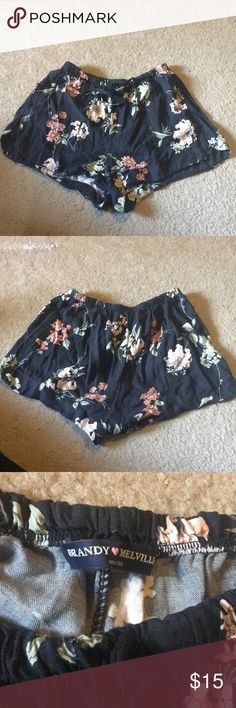 Brandy Melville Japanese Floral Shorts The background is navy blue, with peach and dusty rose colored flowers. These are truly beautiful shorts, almost a piece of art. Drawstring waist is adjustable and the shorts are stretchy and accommodating. One size fits all. Worn once Brandy Melville Shorts