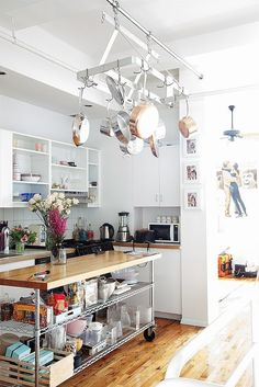 This NYC apartment lacked built-in storage, so the homeowner got creative with hanging kitchen contraptions.