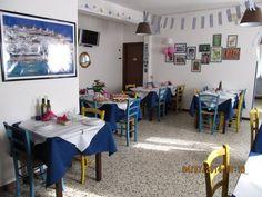 """Arredo Pub Bar Ristoranti Pizzerie MAIERON SNC  www.mobilificiomaieron.it - https://www.facebook.com/pages/Arredamenti-Pub-Pizzerie-Ristoranti-Maieron/263620513820232 - 0433775330. Allestimento Arredamento Ristorante """"Taverna Mykonos"""" a Reggio Emilia .Tavoli 80x80 in legno massello color wenghè cod 806/80, sedie in legno massello cod 3011/P seduta paglia color giallo e Blu . Tutto Produzione Mobilificio maieron arredo pub, bar, ristoranti e pizzerie"""