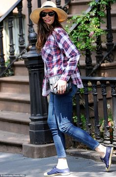 Cute and casual: The daughter of Steven Tyler paired her plaid shirt and jeans with blue sneakers and a hat