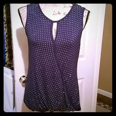 Beautiful navy colored jeweled rayon top Navy colored fancy top with silver studs decorating front and solid in their back. Very nice looking top. Only worn once. 95% rayon and 5% spandex! essentials Tops Blouses