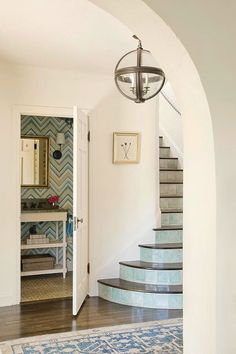 The Zhush: Love the tiled risers on the staircase and that they match the wallpaper/decor of the powder room.