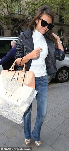 Dressed to impress:The former soap beauty ensured she was prepared for the unpredictable spring weather in the capital by throwing on a black leather biker jacket, and wore a pair of towering silver wedge heels