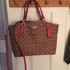 Coach small pink & beige signature Kelsey satchel Just about a month old. Only used lightly. Great condition. Longer strap is for cross body wear. Coach Bags Satchels