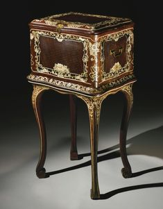 An Italian Rococo ivory-inlaid and parquetry kingwood casket on stand attributed to Pietro Piffetti Piedmont, mid-18th century.