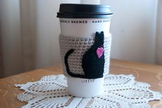 inspiration:  hand crocheted black cat coffee cosy cozy via TableTopJewels on Etsy.