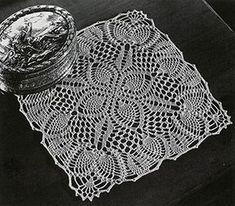 Pineapple Posy Doily crochet pattern originally published in Pineapple Fan Fair, Spool Cotton Co #266.