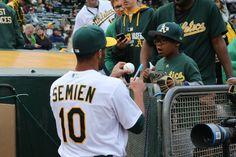 Semien signs an autograph for a fan
