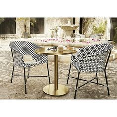 Shop brava dining-lounge grey wicker chair.   All-weather wicker hand woven into a modern diamond pattern in elegant black and white.  Designed by Mermelada Estudio to give personality and energy to any space outdoors or in.