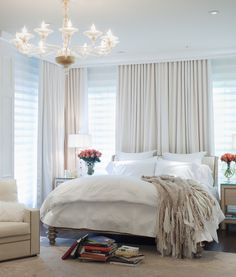 Pretty bedroom.  Like the curtains with the blinds and hidden curtain rod