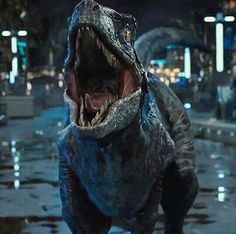 Blue - The Raptor - Jurassic World. Music:  I Got the Power - Snap.  https://www.youtube.com/watch?v=ksR1IGYeJOg
