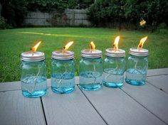 Canning jars repurposed to oil lamps....great idea