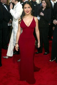 65 Best Golden Globe dresses of all time -     SALMA HAYEK -   Salma Hayek showed off her enviable hourglass figure in this deep crimson corseted Narciso Rodriguez frock back in 2003. Vampy nails, dark golden accessories and matching plum-hued lips completed the ultra-sexy look. Va va voom! (2003)