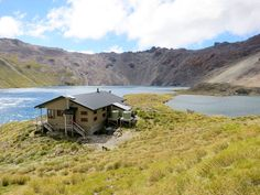 Lake Angelus Hut overlooking the lake - one of the recommended beginner tracks from NZ Wilderness Magazine New Zealand South Island, The Beautiful Country, Glamping, Conservation, Wilderness, In The Heights, Places To Go, National Parks, Scenery