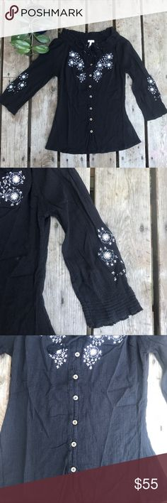 Black joie textured knit Black joie wide shoulder knit top. Has cream flowers Knotted in the front and the back. Has a tassel detail at the front center chest, you can tie it or leave it loose. Has  wood like buttons and a 3/3 sleeve. Very cute shirt 100%cotton Joie Tops Blouses